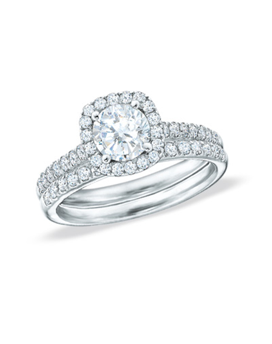 All of love's most precious moments shine through this romantic treasure. In 14K white gold, diamonds totaling 2 cts. create the bridal set of her dreams. Gleaming amid the diamond-studded shank and frame, a 1 ct. round diamond radiates remarkable shine at the center. To accompany your vows, a matching wedding band lined in diamonds completes this beautiful look