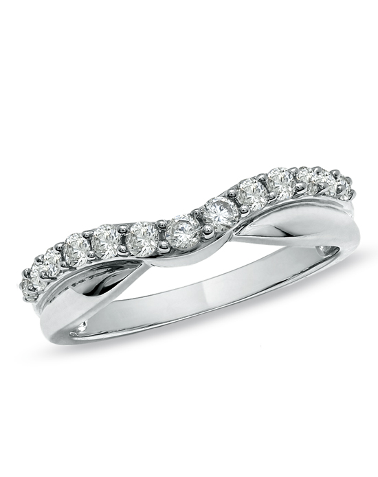 A contemporary style with brilliance and artistry, this twisted contour band is adorned in glittering round diamonds totaling 1/2 ct. Give her the romantic 14K white gold gift on your wedding day, anniversary or just because she's special to you