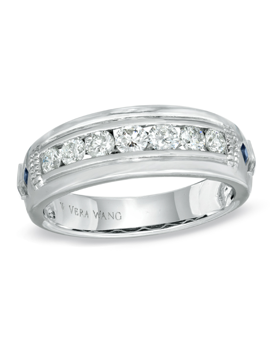 From the Vera Wang LOVE Collection, a ring for him of incomparable beauty and significance. Beautifully crafted in fine 14K white gold, this handsome and distinguished wedding band features a series of seven stunning diamonds aligned in a horizontal frame across the band. Grooved and milgrain detailing gives the frame depth and dimension. Flanking either side of the diamonds, princess-cut bright blue sapphires, a symbol of faithfulness and love, add a brilliant burst of welcome color. Radiant with 3/4 ct. t.w. of diamonds and buffed to a polished luster, this wedding band is a thoughtful symbol of your marriage commitment. The Vera Wang LOVE Collection is available exclusively at Zales