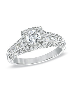 For the unforgettable moments in your life, celebrate with an expression of your love: a 1-3/8 ct. t.w. Celebration 102® diamond engagement ring. Our exclusive diamond offers nearly twice the facets for substantially more sparkle. Stunning and elegant, this ring showcases a 1/2 ct. round Celebration 102® diamond surrounded by a frame of smaller accent diamonds, all cradled in 18K white gold. Additional diamonds line the ring's shank. Every Celebration 102® diamond received excellent rankings for superior cut and color. Insuring authenticity and protection, each diamond is laser-inscribed with a certification number inside of the band. This ring comes with a certificate that includes a photo and a description of the diamond, which guarantees quality and can be used for insurance purposes.