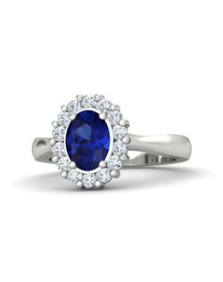 This ballerina-style ring has a ring of gems adding brilliance to the center oval. Inspired by the Princess Diana's ring, now worn by Kate Middleton, this classic style has a timeless elegance. Customize with your choice of 24 gemstones and 9 precious metals.