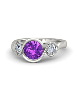 This graceful three-stone ring design with three round brilliant gemstones has curves that embrace the gems in an unusually elegant way. Customize with your choice of 24 gemstones and 9 precious metals.