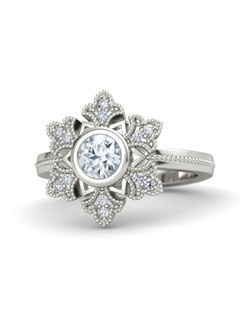 This intricate, vintage-inspired snowflake ring holds 12 accent stones and a round-cut, 5mm center stone. It's carefully handcrafted in your choice of 26 gemstones and 9 metals.