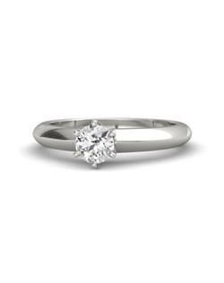 This simple solitaire engagement ring is gorgeous for everyday wear and features a single round-cut gemstone. It is carefully handcrafted in your choice of 26 gemstones and 9 precious metals.