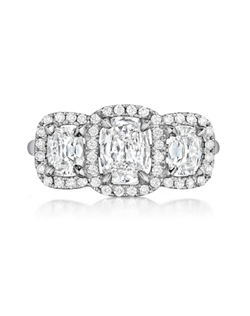 Pavé halo ring featuring three Signature Daussi Cushion™ cut diamonds
