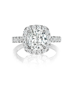 Pavé halo ring featuring a 2.37Ct Signature Daussi Cushion™ cut diamond with 1.35Ct of accent diamonds.