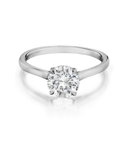 Solitaire ring handmade to accentuate any center diamond. Features a 1.25Ct. Round brilliant diamond