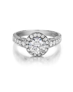 Pavé halo diamond ring handmade to accentuate any center diamond. Featured with a 1.50Ct. Round brilliant diamond