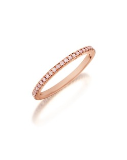 Pavé rose gold eternity diamond  band featuring a single line of round brilliant natural fancy light pink diamonds. Available with diamonds half way around the band or eternity. 0.15-0.30Ct