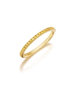 Pavé yellow gold eternity diamond band featuring a single line of round brilliant natural fancy yellow diamonds. Available with diamonds half way around the band or eternity. 0.15-0.30Ct.
