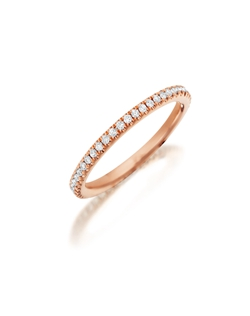 Pavé rose gold eternity diamond band featuring a single line of round brilliant diamonds. Available with diamonds half way around the band or eternity. 0.15-0.30Ct.