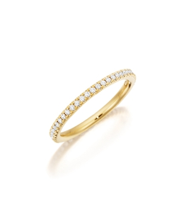 Pavé yellow gold eternity diamond band featuring a single line of round brilliant diamonds. Available with diamonds half way around the band or eternity. 0.15-0.30Ct.