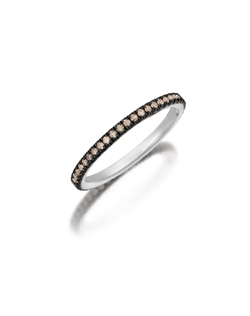 Pavé white gold eternity band featuring a single line of round brilliant natural fancy brown diamonds with black rhodium prongs. Available with diamonds half way around the band or eternity. 0.15-0.30Ct