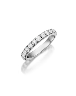 Pavé white gold eternity band featuring a single line of round brilliant diamonds. Available with diamonds half way around the band or eternity. 0.75-1.50ct