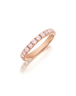 Pavé rose gold eternity band featuring a single line of round brilliand fancy light pink diamonds. Available with diamonds half way around the band or eternity. 0.75-1.50Ct