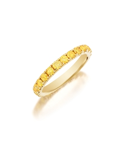 Pavé yellow gold eternity band featuring a single line of round brilliant fancy yellow diamonds. Available with diamonds half way around the band or eternity. 0.75-1.50Ct