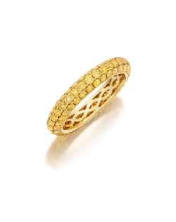 Pavé yellow gold eternity band featuring three rows of round brilliant fancy yellow diamonds. Available with diamonds half way around the band or eternity. 1.00-2.10Ct.