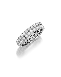 White gold eternity band featuring two rows of of round brilliant pavé set diamonds. Available with diamonds half way around the band or eternity. 1.20-2.35Ct