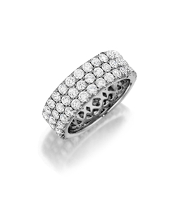 White gold eternity band featuring three rows of round brilliant pavé set diamonds. Available with diamonds half way around the band or eternity. 1.70-3.40Ct