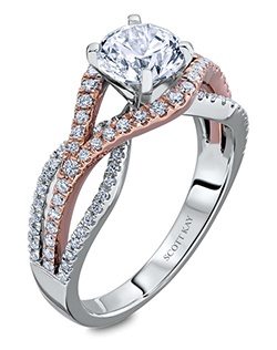 Through handcrafted design and sculpting through feeling, the Radiance engagement ring siginifies the brilliance of simplistic elegance. This unique two-toned 14K white gold and pink rose gold ring has a 1ct round center stone diamond. Also available in platinum, 18K white or yellow gold, 14K yellow gold, and palladium.