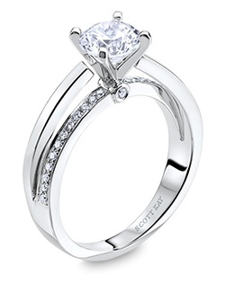 Through handcrafted design and sculpting through feeling, the Radiance engagement ring siginifies the brilliance of simplistic elegance. This 14K white gold ring has a 0.14ctw and a 1ct round center stone diamond. Also available in platinum, 18K white or yellow gold, 14K yellow gold, and palladium. 
