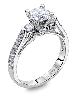 Through handcrafted design and sculpting through feeling, the Radiance engagement ring siginifies the brilliance of simplistic elegance. This stunning 14K white gold Scott Kay ring has a 0.42ctw and a 1ct round center stone diamond. Also available in platinum, 18K white or yellow gold, 14K yellow gold, and palladium. 