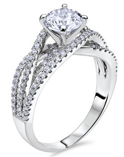 Through handcrafted design and sculpting through feeling, the Radiance engagement ring siginifies the brilliance of simplistic elegance. This stunning 14K white gold Scott Kay ring has a 0.48ctw and a 1ct round center stone diamond. Also available in platinum, 18K white or yellow gold, 14K yellow gold, and palladium. 