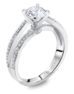 Through handcrafted design and sculpting through feeling, the Radiance engagement ring siginifies the brilliance of simplistic elegance. This eloquent 14K white gold Scott Kay ring has a 0.22ctw and a 1ct round center stone diamond. Also available in platinum, 18K white or yellow gold, 14K yellow gold, and palladium.  