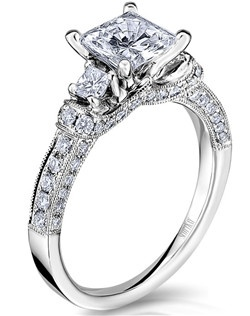 The Tiara engagement ring is sculpted and designed to symbolize honored heritage, tradition, and legacy. This handcrafted 14K white gold future family heirloom has a 0.68ctw and a 1ct princess center stone diamond. Also available in platinum, 18K white or yellow gold, 14K yellow gold, and palladium. 