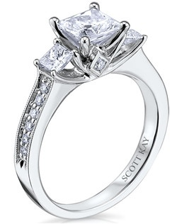 Scott Kay's Signature Crown setting represents and symbolizes the notions of royal, regal, and rich. This delicate and mystifying 14K white gold engagement ring has a 0.57ctw and a 1ct princess center stone diamond. Also available in platinum, 18K white or yellow gold, and palladium. 