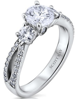 Through handcrafted design and sculpting through feeling, the Radiance engagement ring siginifies the brilliance of simplistic elegance. This eloquent 14K white gold Scott Kay ring has a 0.61ctw and a 1ct round center stone diamond. Also available in platinum, 18K white or yellow gold, 14K yellow gold, and palladium. 