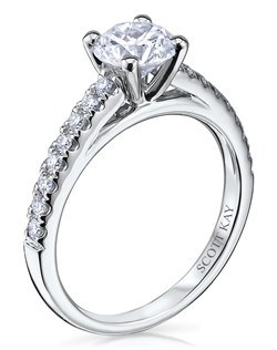 Through handcrafted design and sculpting through feeling, the Radiance engagement ring siginifies the brilliance of simplistic elegance. This eloquent 14K white gold Scott Kay ring has a 0.26ctw and a 1ct round center stone diamond. Also available in platinum, 18K white or yellow gold, 14K yellow gold, and palladium. 
