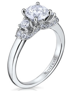 The Tiara engagement ring is sculpted and designed to symbolize honored heritage, tradition, and legacy. This handcrafted future family heirloom has a 0.38ctw and a 1ct round center stone diamond. Also available in platinum, 18K white or yellow gold, 14K yellow gold, and palladium. 