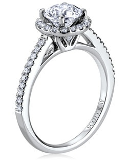 The significance of Luminaire is encrypted within its encircled galaxy of brilliance. This elegant 14K white gold Scott Kay ring has a 0.29ctw and a 1ct round center stone diamond. Also available in platinum, 18K white or yellow gold, 14K yellow gold, and palladium.     Like us on Facebook: https://www.facebook.com/scottkayusa       Follow us on Twitter: @scottkay