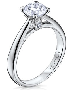Through handcrafted design and sculpting through feeling, the Radiance engagement ring siginifies the brilliance of simplistic elegance. This eloquent 14K white gold Scott Kay ring has a 0.03ctw and a 1ct round center stone diamond. Also available in platinum, 18K white or yellow gold, 14K yellow gold, and palladium. 