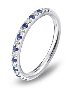 Delicate and brilliant, this Blue Nile platinum wedding band features alternating pavé set diamonds and sapphires for a classic and colorful look.