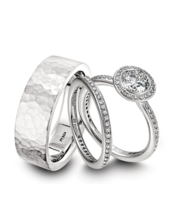 Ritani platinum and diamond engagement ring with matching platinum wedding band and men's platinum wedding band.