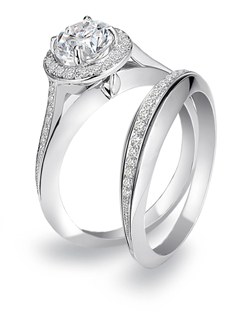 Uneek by Benjamin Javaheri platinum and diamond bridal ring set features a 1 carat cushion center for a 1.50cttw.