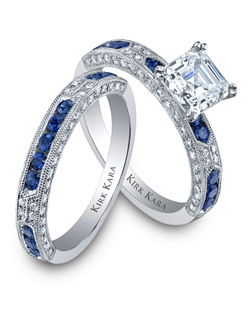 Platinum and diamond Amelia engagement ring and wedding band accented with round sapphires.