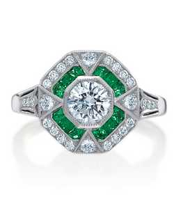 Platinum vintage semi-mount ring by Armadani featuring french cut emeralds and round diamonds.
