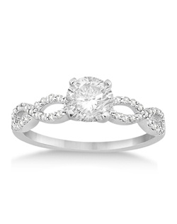 This unique infinity diamond engagement ring for women has an unusual twisted band lined with approximately 42 round-cut, micro pave-set diamonds.