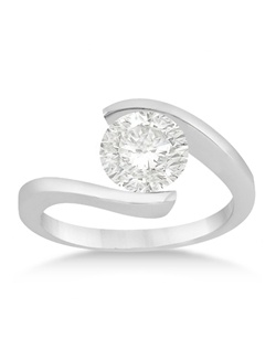 This contemporary solitaire diamond engagement ring for women features a twist style band and has a unique design that includes a tension setting mounting.