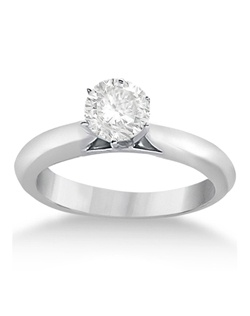 This stunning six-prong mounted solitaire engagement ring for women is designed to perfectly complement your choice of diamond shape and size. The sides of the band arch toward the center stone, creating a refined appearance.