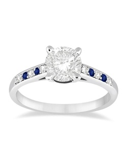 This unique cathedral style designer engagement ring for women contains 4 blue sapphires alternating with 6 brilliant cut round diamonds, which sit on either side of a prong-mounted diamond center stone.