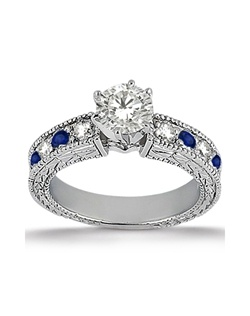 and the unique artistic design around this heirloom engagement ring ...