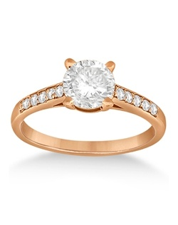 This stunning side stone accented diamond engagement ring for women features 10 brilliant-cut round diamonds pave-mounted on a 14 karat rose gold (pink) Cathedral style band.