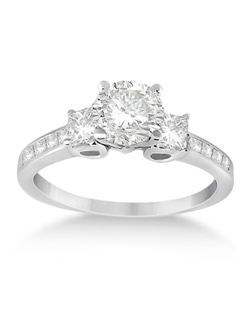 This gorgeous 14 karat white gold engagement ring for women includes approximately fourteen princess cut (square) diamonds, with two larger ones prong-mounted next to your choice of diamond center stone.