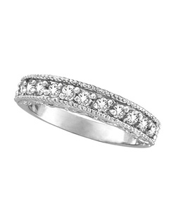 This beautiful Morris and David half-eternity designer wedding band displays 11 sparkling, round-cut diamonds, milgrain edges, and a carved infinity design on the sides of a 14 karat white gold band.