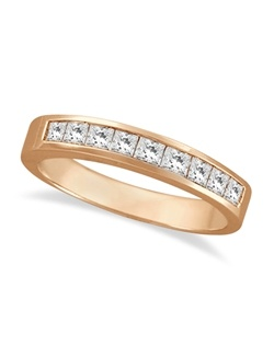 A 14 karat rose gold (pink) wedding band displays 9 princess-cut (square) diamonds in a sleek channel setting. This ring can also be worn as an anniversary ring or a right hand fashion ring.