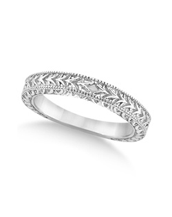 This heirloom style 14 karat white gold wedding band features a fancy engraved leaf design and milgrain edges.